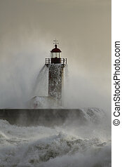 Old lighthouse covered by stormy waves - Old lighthouse of...