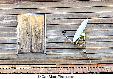 Satellite dish is attached to the old wooden house, Bangkok,...