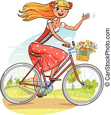 Beautiful girl rides a bicycle and waving