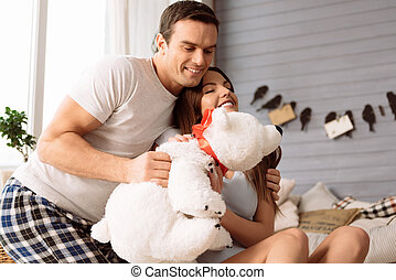 Cheerful young couple hugging a stuffed toy - Our favourite...