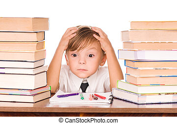 Boy with books - Six year old boy surrounded by piles of...