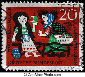 witch gives the girl an apple - WEST GERMANY - CIRCA 1965: A...