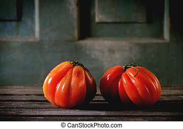 Big red tomatoes RAF - Two big red tomatoes RAF over old...