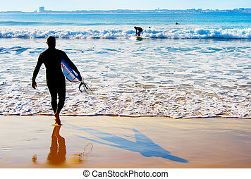 Surfer going to surf - Surfing in the Atlanctic ocean....