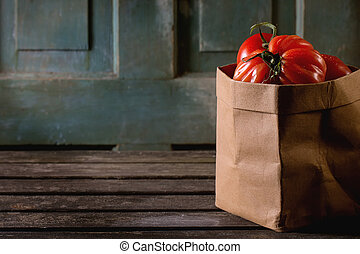 Big red tomatoes RAF - Heap of big red tomatoes RAF in paper...