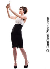 elegant woman with a mobile phone - elegant woman taking a...