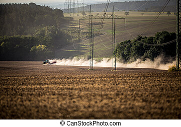 Tractor plowing a dry farm field