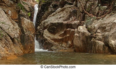 Mountain River Waterfall Cascade Runs among Bare Stones -...