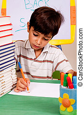 Young kid busy in drawing