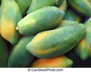 Green Papayas - A pile of fresh green papayas in a basket