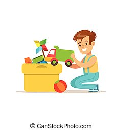 Boy Putting His Toys In Special Box Smiling Cartoon Kid...