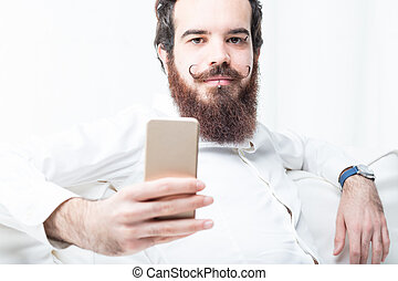 you can do it online says this bearded man - young man with...