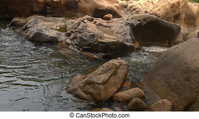 Large Brown Boulders on Mountain River in Park - closeup...