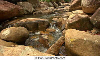 Conglomeration of Large Brown Boulders by River in Park -...