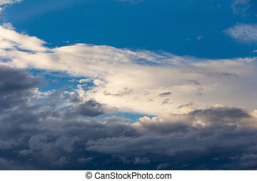 Color of dramatic sky with stormy sunset clouds.