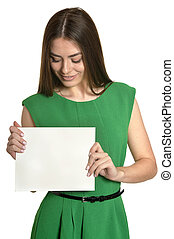 beautiful young woman with empty paper posing against white