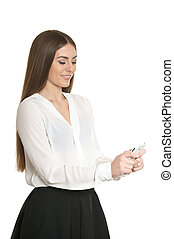 beautiful young woman with phone posing against white