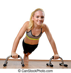 Girl during exercise pectoral muscles on white background....