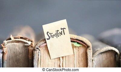 student idea, label and vintage books