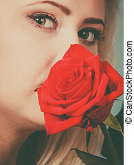 Gorgeous woman holding red rose flower. - Gorgeous adorable...