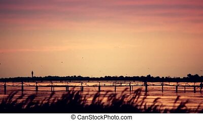 Landscape over lake or river with lighthouse far off -...