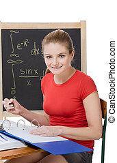 Caucasian schoolgirl by desk studying math exam - University...