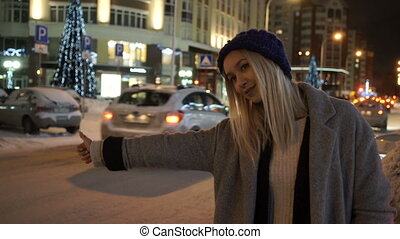 The girl catches the car in winter