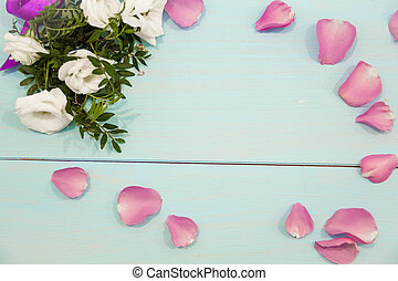 Flowers layout on white rustic background. a bouquet of...