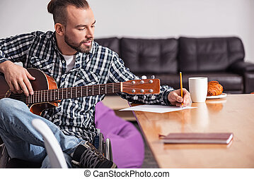 Talented handicapped guy writing song lyrics - Adding...