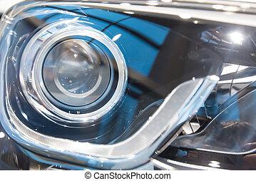 Close-up headlights of car - Closeup photograph of...
