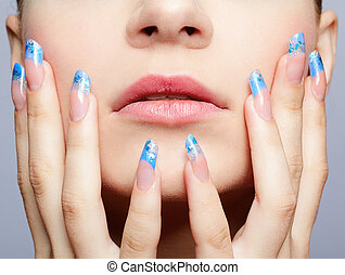 manicure - close-up portrait of girl's lower part of face...