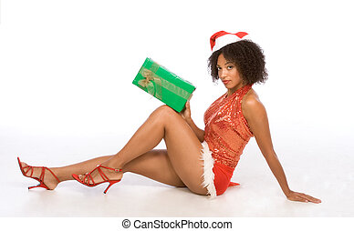 Sexy ethnic woman in hat with Christmas gift - Sexy female...