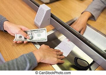 customer with money taking receipt from bank clerk - people,...