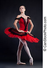 ballerina - modern style dancer posing on studio background