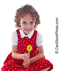 little girl wearing red dress is stitting with a flower in...