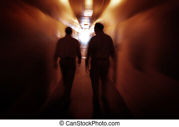 Two men walking through Tunnel Exploring New Places - Two...