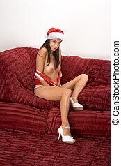 Sexy seductive Mrs. Claus in Christmas outfit