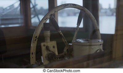 Close-up of the ship's a steering wheel