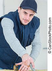 Male worker using stanley knife
