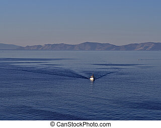 Fishing boat in calm blue sea.