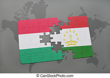 puzzle with the national flag of hungary and tajikistan on a...