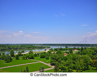 Belgrad Danube river view over green park. - Confluence of...