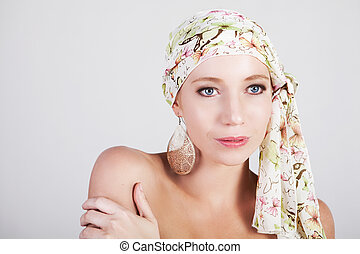 Beautiful Woman in a Colorful Headscarf - Head and shoulders...