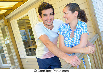 Couple on terrace of mobile home