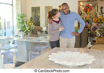 Couple in home furnishings shop