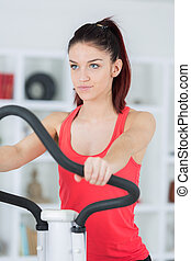 Lady using exercise equipment at home