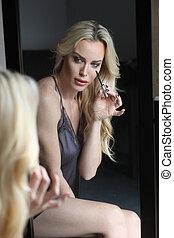 Beautiful Blond Woman with Green Eyes Applying Mascara -...