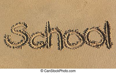 school written on sand