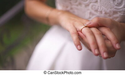 closeup of bride watchin wedding ring close-up