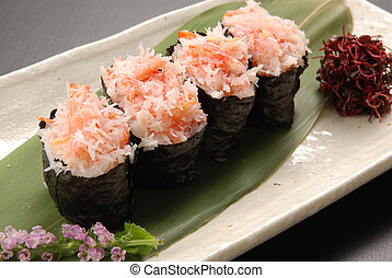 Red snow crab loosened kimbap on green leaf tray in...